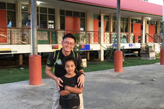 Travelbay Borneo Private Tours - Jesse and guide at a local school