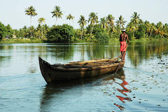Travelbay Sri Lanka & India Tours - 14 Day Special Private Tour including Wildlife, Spices, Tea Plantation, Houseboat and Beaches - Sri Lanka & India Private Tours - Man in Boat, Kerala