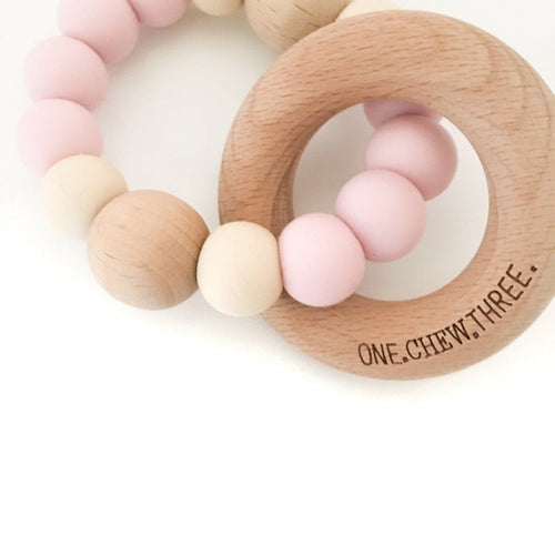 SINGLE SILICONE BEECH TEETHING RATTLE PALE PINK/CREAM