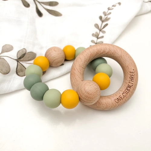 SINGLE SILICONE BEECH TEETHING RATTLE WATTLE (GREEN/GOLD)
