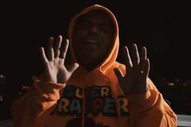 "Smiley wearing Super Trapper in ""30"" Video"