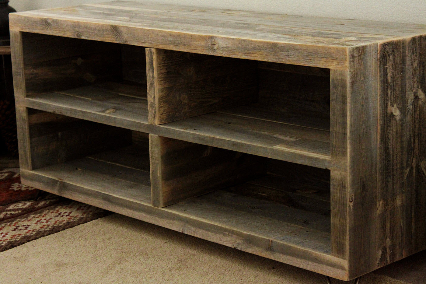 Made from solid reclaimed Wyoming wood snow fence, it offers generous  storage for media components. Each unit is designed, built, and finished by  a single ... - Alamo Reclaimed Wood Bookshelf - The Spotted Door