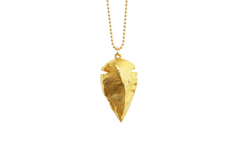 Gold arrowhead pendant