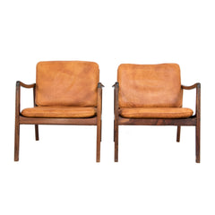 #1083 Pair of Leather and Rosewood Lounge Chairs by Ole Wanscher