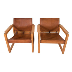 "#437 Pair of Leather ""Safari"" Chairs"
