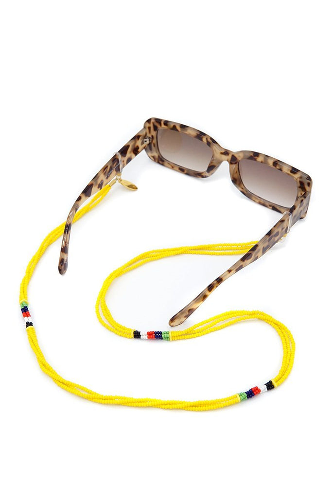 Njano Sunnycord handmade in Kenya with yellow glass beads, attached to sunglasses.