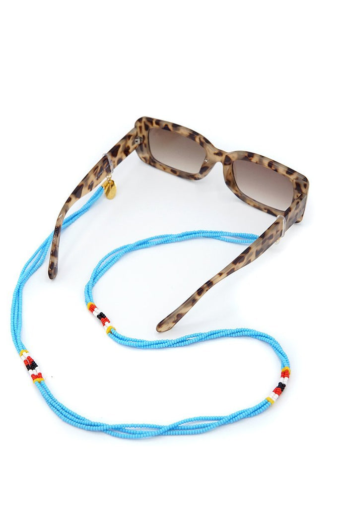 Anga Sunnycord handmade in Kenya with blue glass beads, attached to sunglasses.