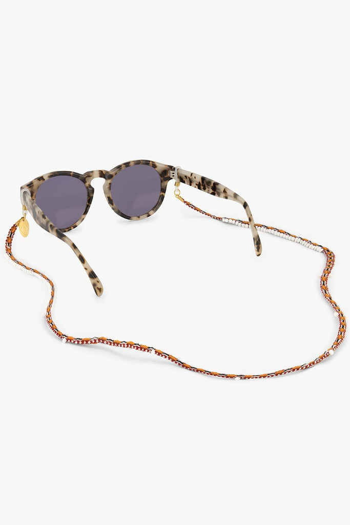 Luna Sunnycord handmade in Peru, made of orange, red and brown woven colours and glass beads, attached to sunglasses.