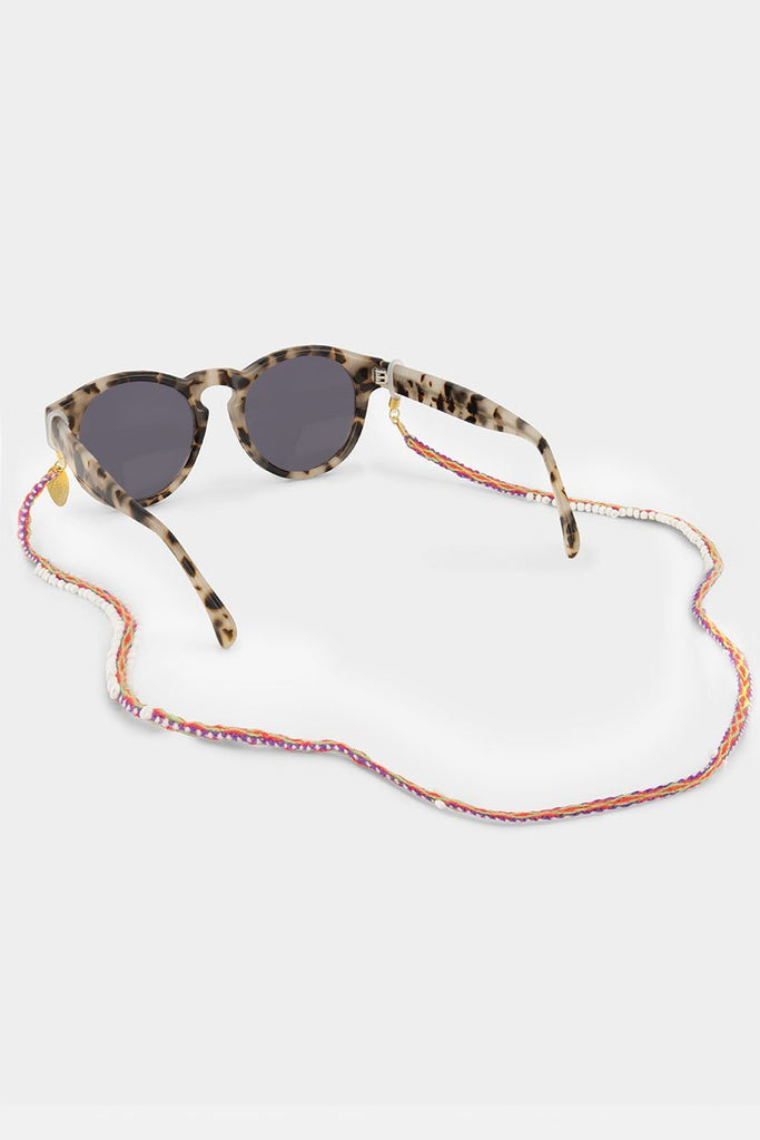 Blanca Sunnycord handmade in Peru, made of pink, green and purple woven colours and glass beads, attached to sunglasses.