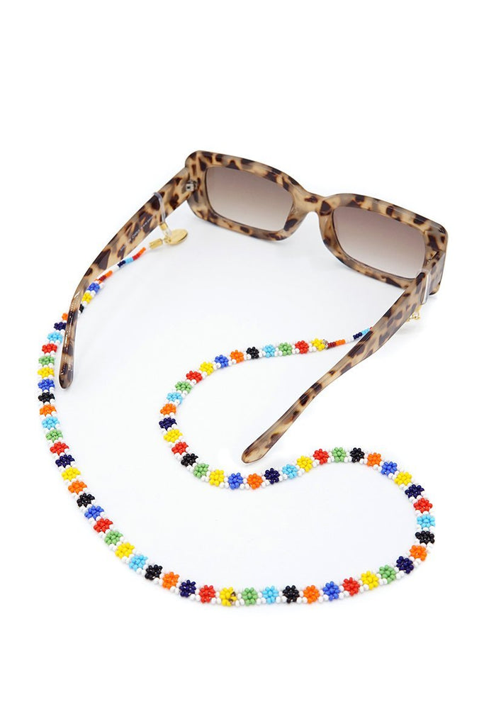 Handmade Maua Sunnycord made of colourful glass beads with floral detail, attached to sunglasses.