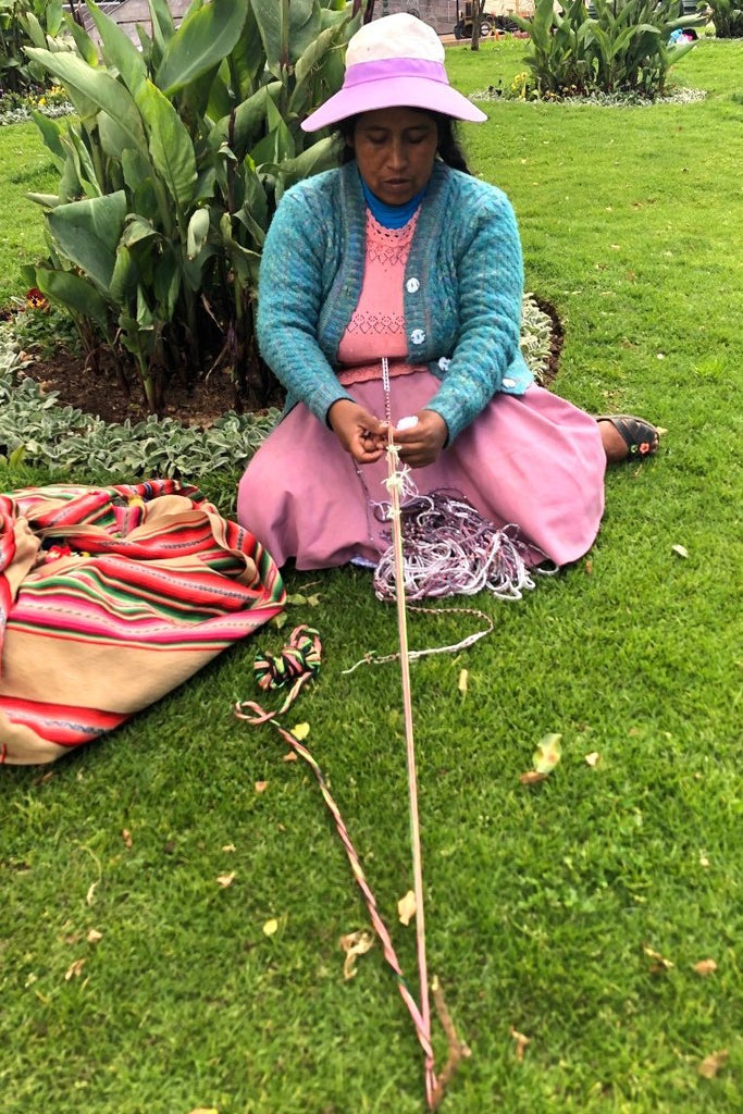 Local woman in Peru working on her handmade Sunnycord using the backstrap loom method.