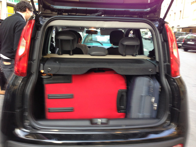 Here is the car I spent the day hiding my eyes in. The red bag is...
