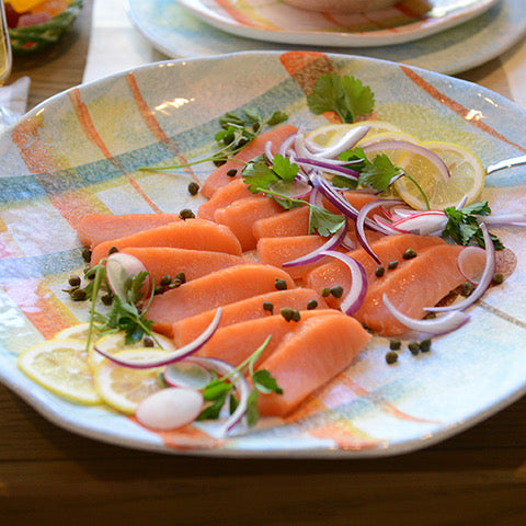 smoked salmon on handmade dinner plate