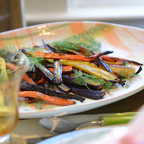 roasted carrots on handmade ceramic plate