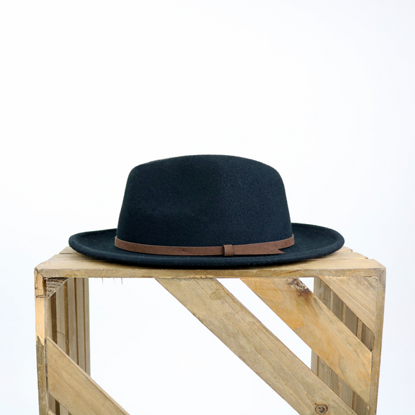 fedora hat on a wooden crate