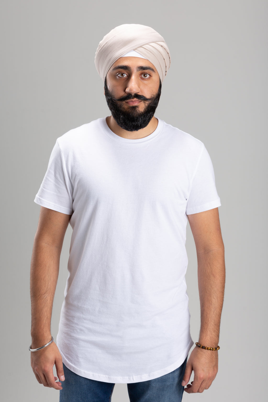 Sikh Man Wearing a Beige Turban Keski