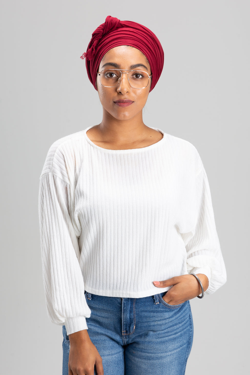 Sikh Woman Wearing a Maroon Turban Keski