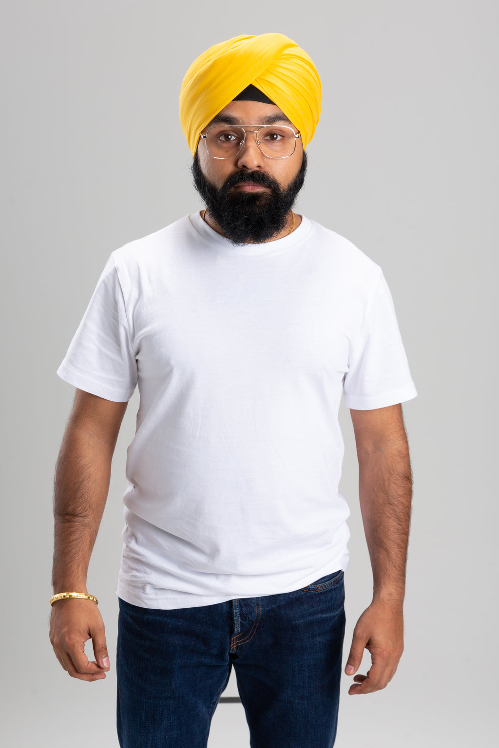 Sikh Man Wearing a Yellow Turban Keski