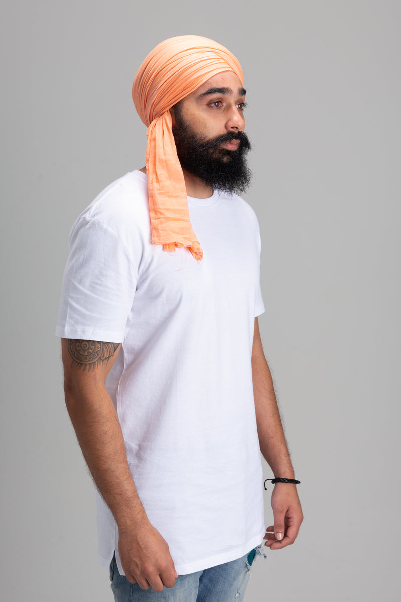 Sikh Man Wearing a Peach Turban Keski