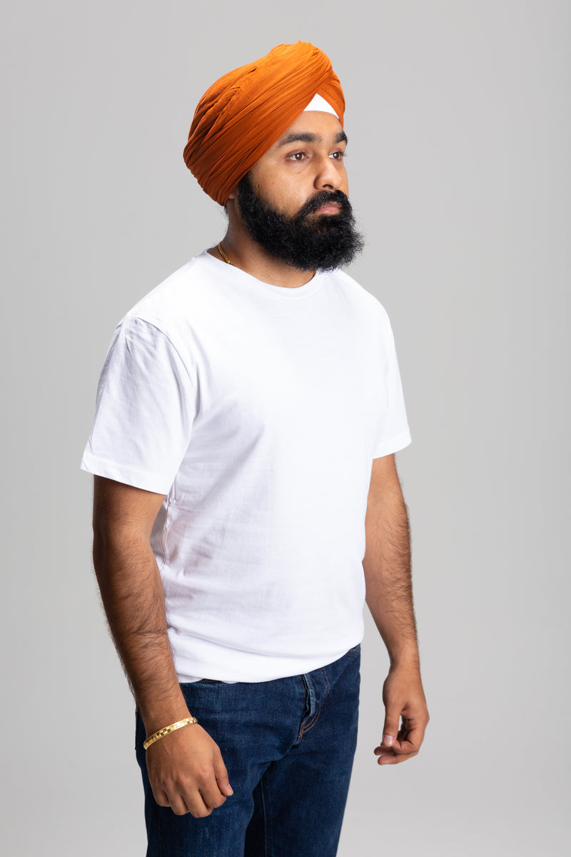 Sikh Man Wearing a Rust Turban Keski