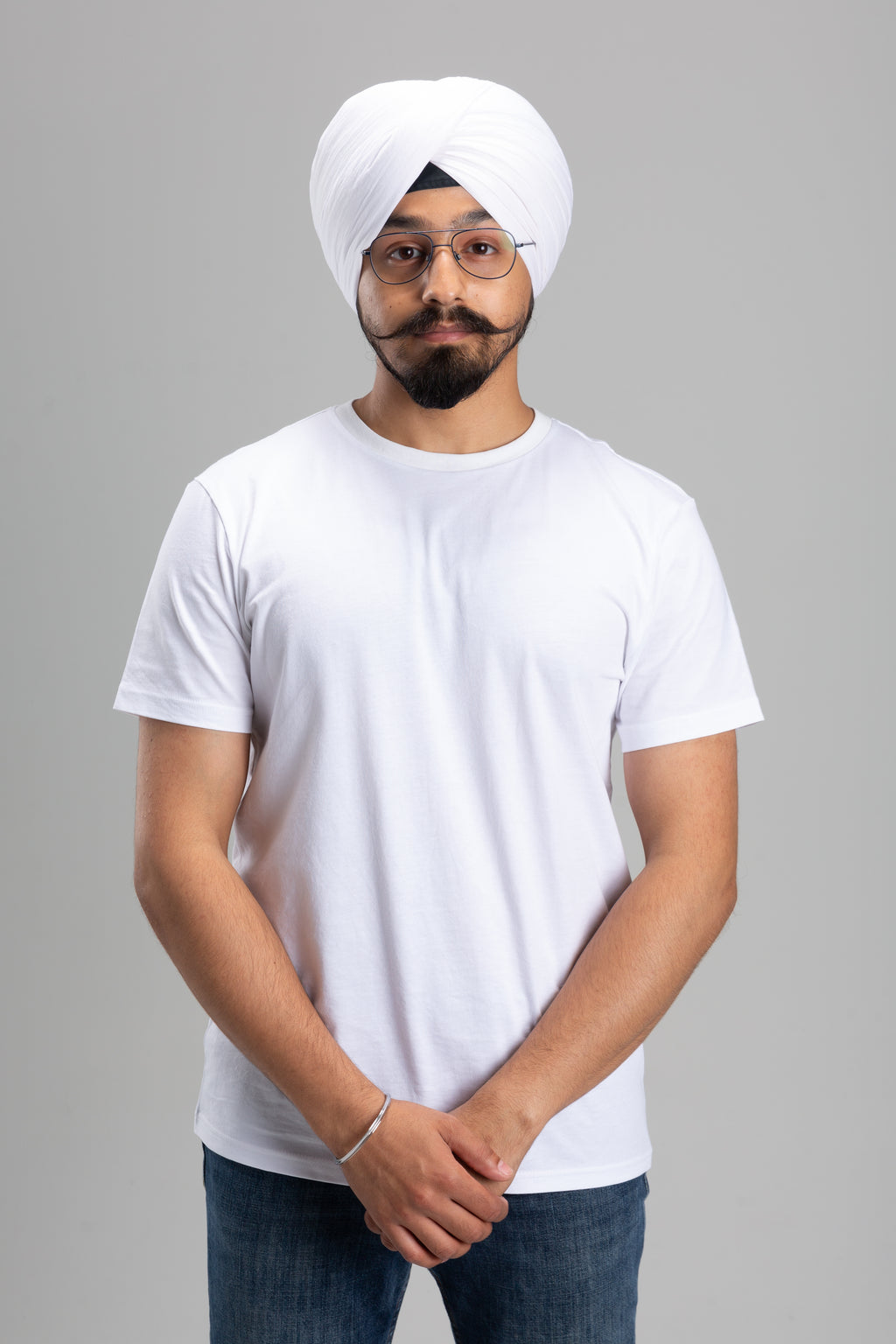 Sikh Man Wearing a White Turban Keski