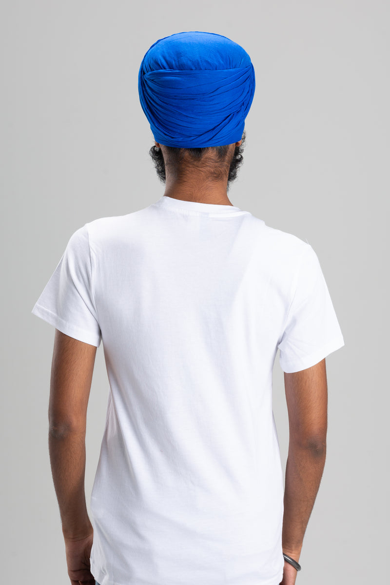 Sikh Man Wearing a Blue Turban Keski
