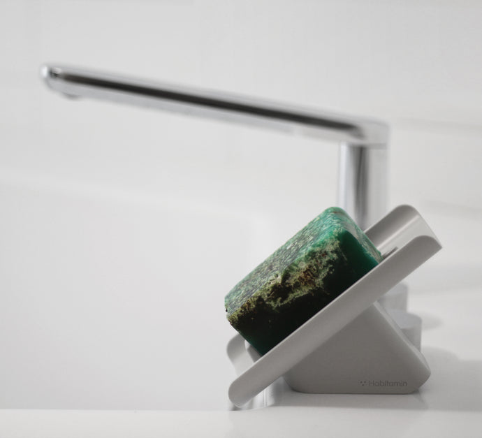 The slanted soap dish, saver, waterfall, drains water into the bathroom sink perfectly