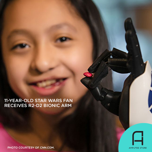 Isabella Tadlock picks up a piece of chocolate with her R2-D2 bionic arm.