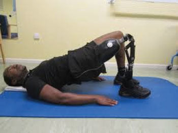 Amputee performing pelvic tilt for low back pain.