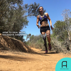Below-knee amputee sweating excessively while running on a trail.