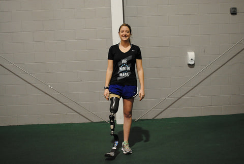 An above-knee amputee performs the one-leg standing balance exercise while wearing a prosthetic limb.