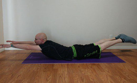 Incorporating supermans into your exercise routine will help strengthen the muscles at both sides of your spine.