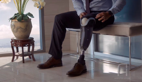 Dwayne Johnson putting on his prosthetic leg.