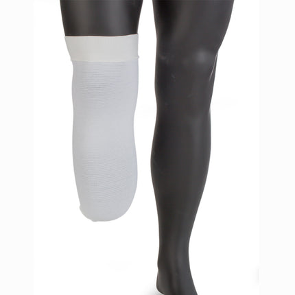 Knit rite prosthetic shrinker with 4-way stretch in color white to control limb swelling.