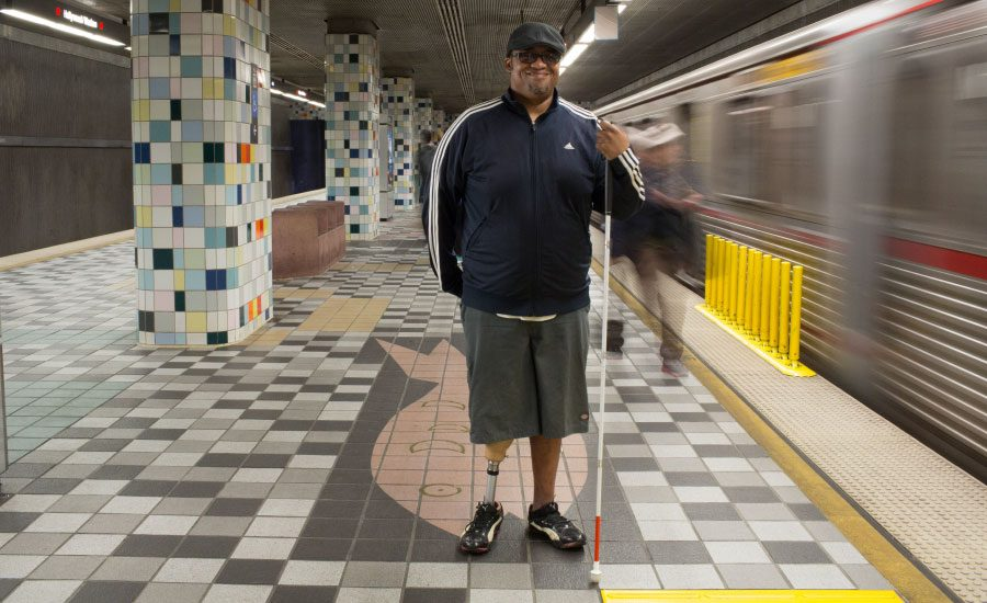 Blind and a below knee amputee rides public transportation to work wearing his stump socks.