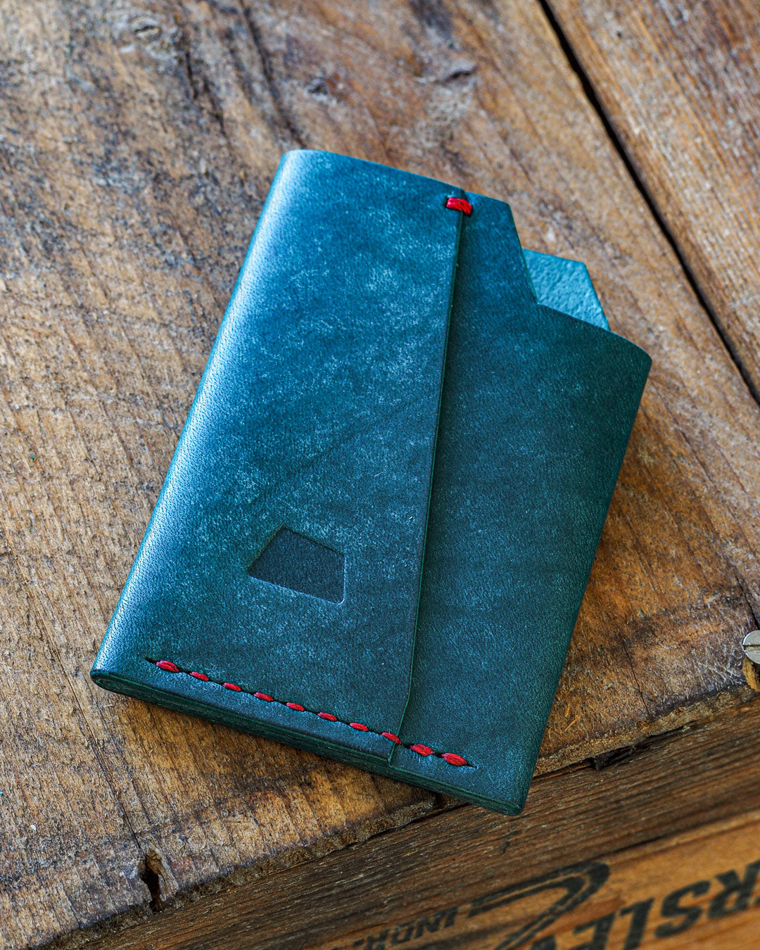 This Luava handmade leather wallet is Vortex. It's handcrafted in Finland with vegetable-tanned, full-grain leather. It's a card holder for seven cards and folded cash. Compact and minimalistic wallet with unique design.
