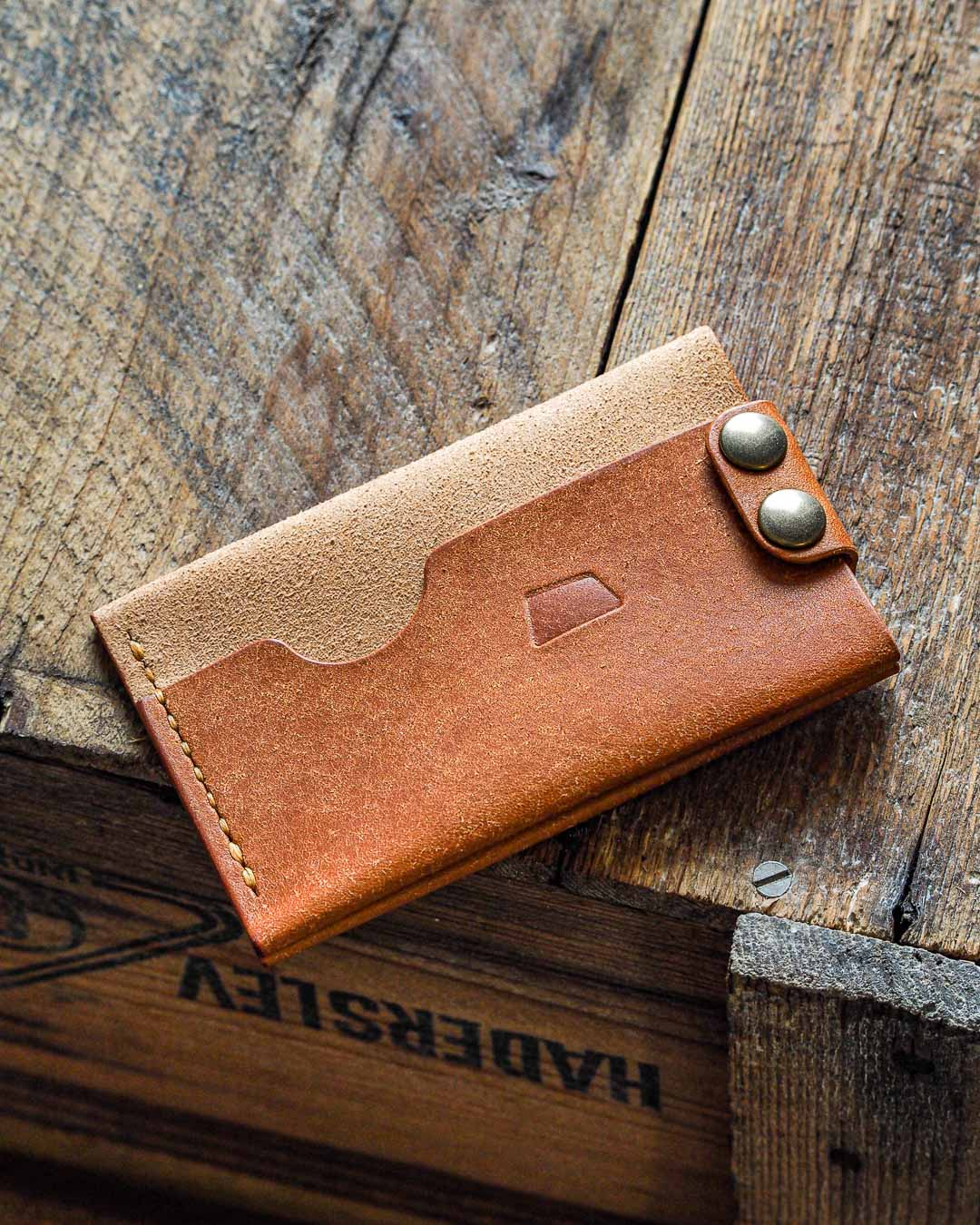 Luava handmade leather wallet. handcrafted flat wallet is a card holder made with badalassi carlo pueblo cognac. it's veg-tan full-grain cow leather from Italy. Flat wallet has a place for six cards and folded cash.