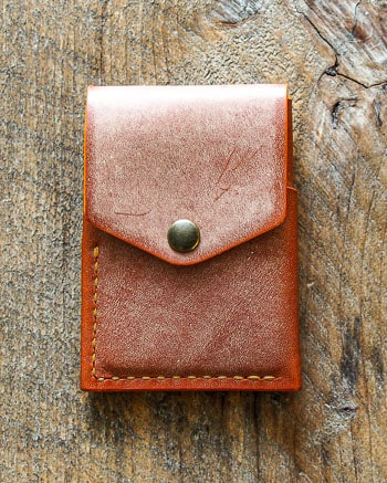 Luava handmade leather wallet overfold made with chost whiskey. Many pockets for all your cards, cash and even coins. Handcrafted in Finland.