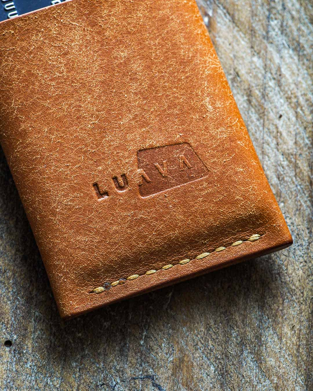 Luava handmade leather wallet handcrafted card holder cardholder made in finland vortex badalassi pueblo cognac back logo in use