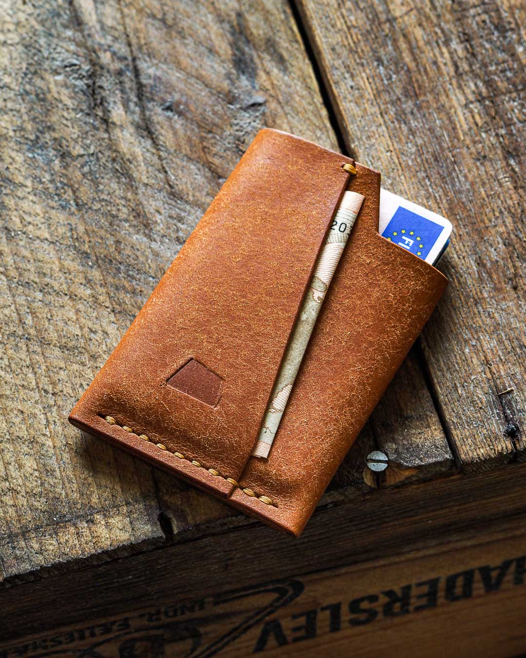 Luava handmade leather wallet handcrafted card holder cardholder made in finland vortex badalassi pueblo cognac front in use