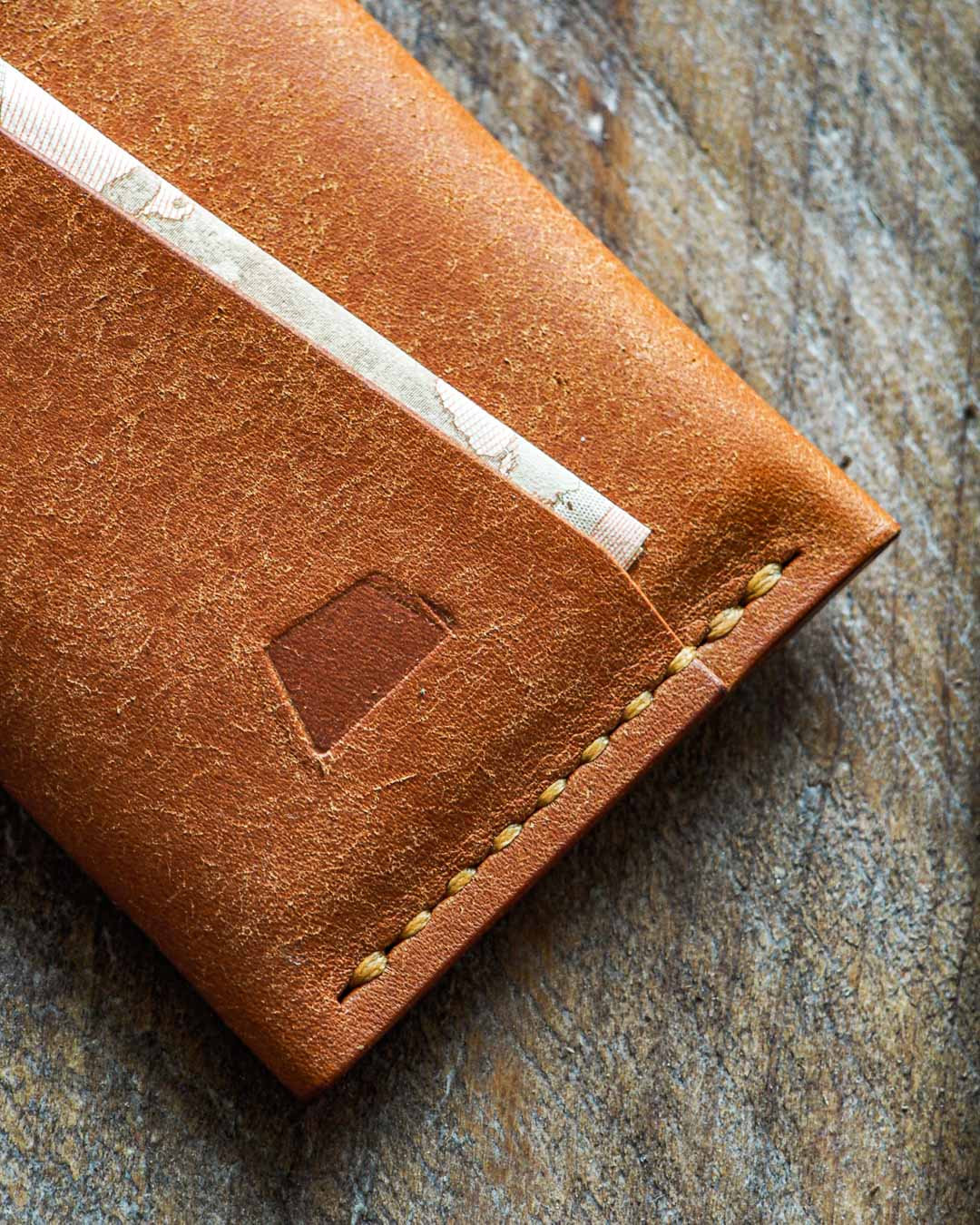 Luava handmade leather wallet handcrafted card holder cardholder made in finland vortex badalassi pueblo cognac front logo in use