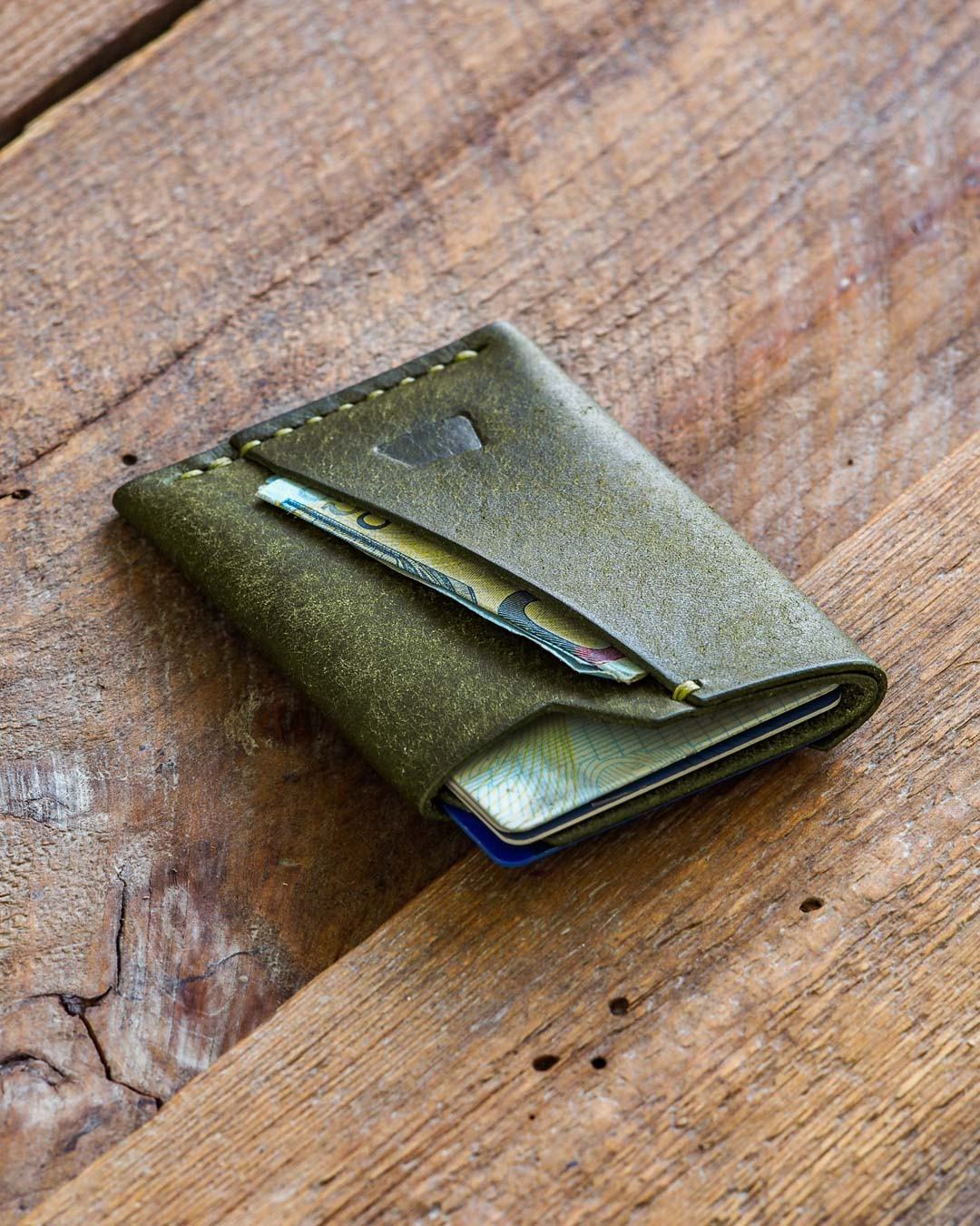 Luava handmade leather wallet handcrafted card holder cardholder made in finland vortex pueblo olive front in use angle