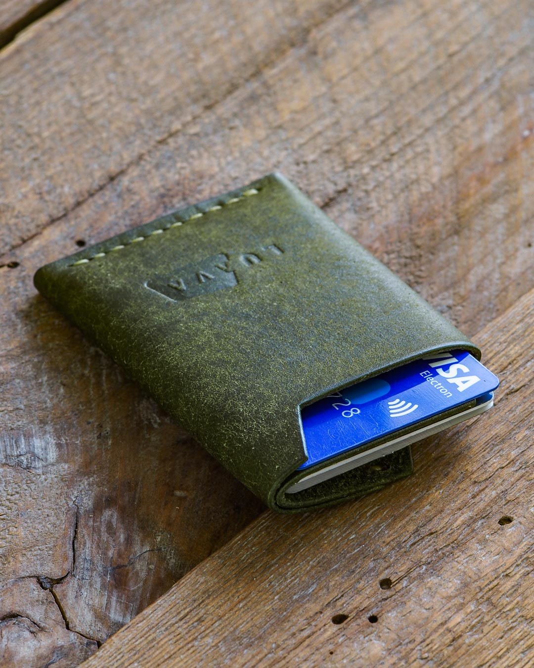 Luava handmade leather wallet handcrafted card holder cardholder made in finland vortex pueblo olive back in use angle