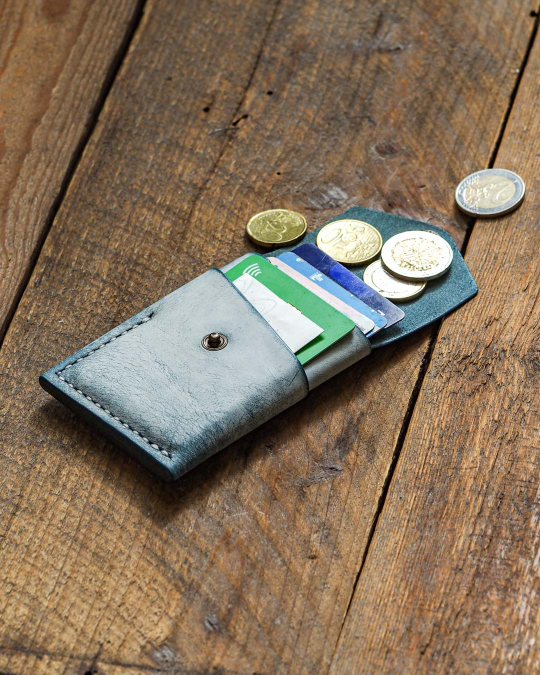 Luava handcrafted leather overfold wallet ghost ocean conceria la bretagna cardholder card holder handmade in finland angle fron open in use