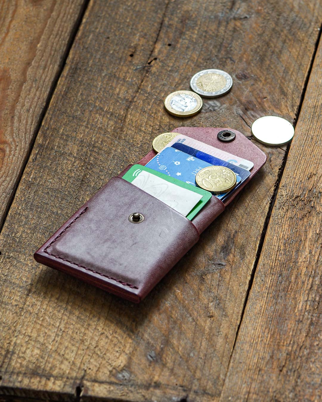 Luava handcrafted leather overfold wallet ghost burgundy conceria la bretagna cardholder card holder handmade in finland angle front open in use