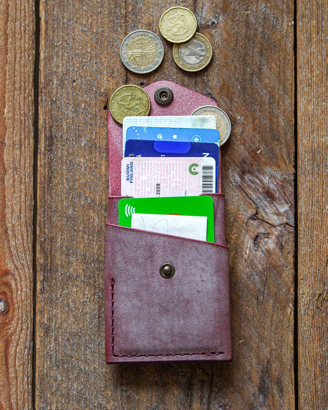 Luava handcrafted leather overfold wallet ghost burgundy conceria la bretagna cardholder card holder handmade in finland front open in use