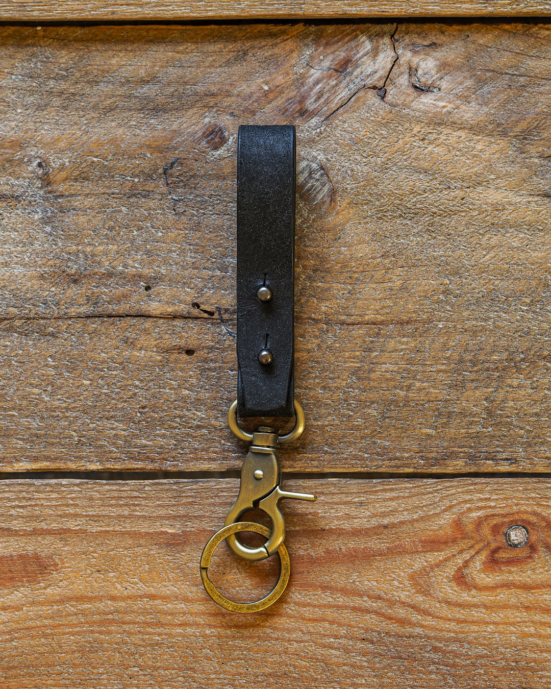 Luava handcrafted leather key fob double vegetable tanned keychain brass keyring clasp metal stud badalassi carlo pueblo leather handmade in finland black