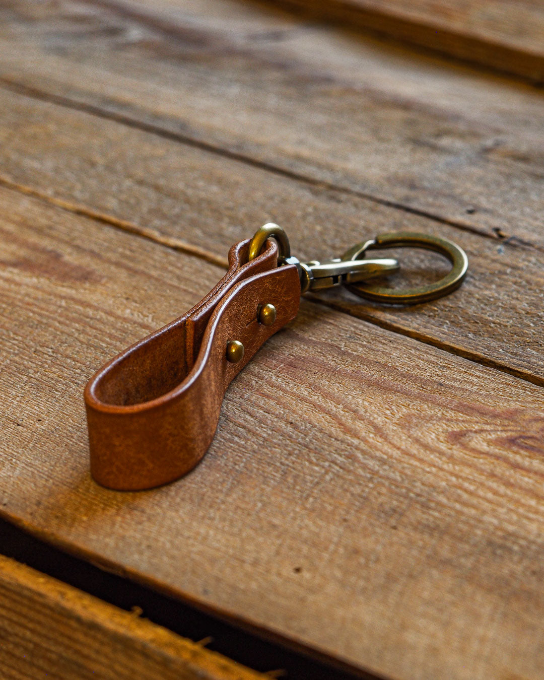 Luava handcrafted leather key fob double vegetable tanned keychain brass keyring clasp metal stud badalassi carlo pueblo leather handmade in finland cognac side