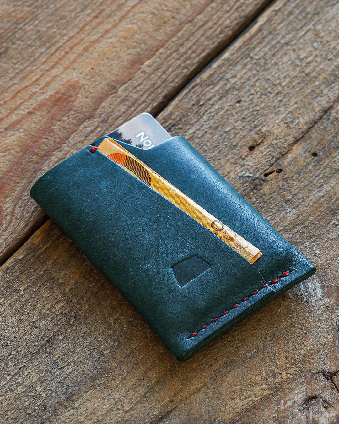 Luava handmade leather wallet handcrafted card holder wrap cardholder made in finland vortex maya turquoise front in use angle