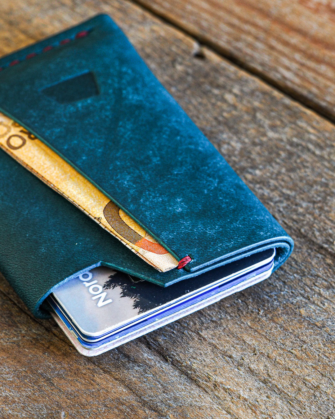 Luava handmade leather wallet handcrafted card holder wrap cardholder made in finland vortex maya turquoise front in use angle close up